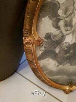 Ancien Cadre à vue ovale en bois doré de style Louis XV époque début XX ème s