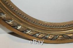 Ancien cadre en bois et stuc doré, ovale, style Louis XVI