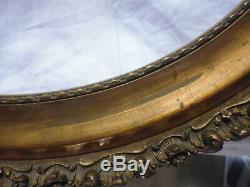 Ancien grand cadre oval bois et stuc doré à la feuille style Rocaille Rococo