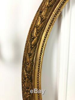 CADRE / ENCADREMENT OVALE D'ÉPOQUE NAPOLÉON III EN BOIS DORÉ (74 x 59,5 cm)