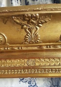 CADRE en bois doré époque Empire