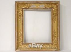 Cadre Empire bois stuqué doré palmettes fleurettes XIXème siècle