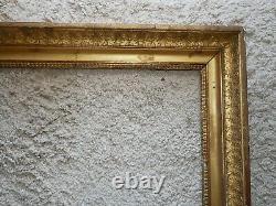 Cadre Empire en bois plâtré doré, décor de palmettes, clefs, 73/62, XIXe