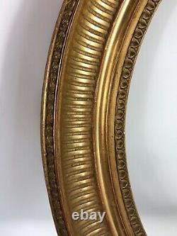 Cadre Ovale à cannelures bois sculpté doré à la feuille, XIXe siècle 49,5x44cm