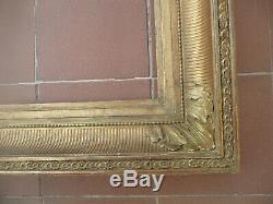 Cadre a canaux époque fin 19ème en bois et stuc doré