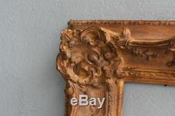 Cadre à oreilles stuc doré époque XXème