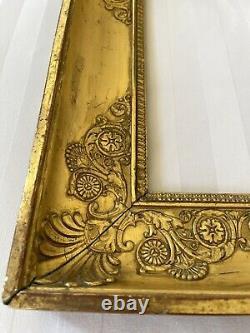 Cadre ancien à palmettes époque Empire XIXè en bois doré montage à clefs clé