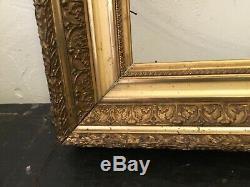 Cadre ancien en bois et stuc doré dimensions de feuillure 53x45 cm