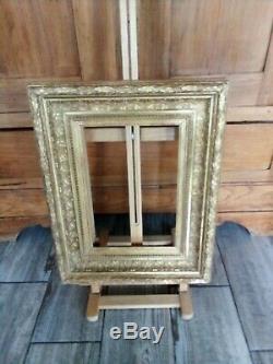 Cadre ancien ornementé en bois doré d'origine, angles propres intérieur 30x21 cm