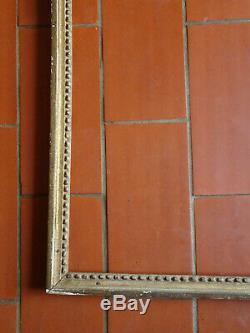 Cadre baguette Louis XVI en bois sculpté et doré. XVIII°