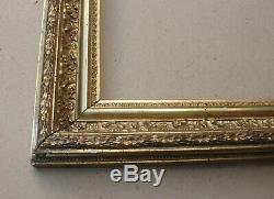 Cadre barbizon en bois et stucs doré fin XIXe S. Feuillure 63,5 x 47,5 cm
