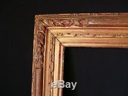 Cadre bois sculpté de style doré à clefs