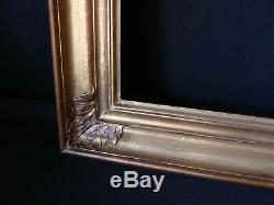 Cadre doré à clefs bois et stuc ancien