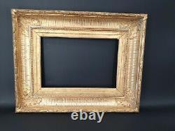 Cadre en bois doré époque XIX ème S de style Empire