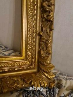 Cadre en bois et stuc doré XIXème, décors de rinceaux