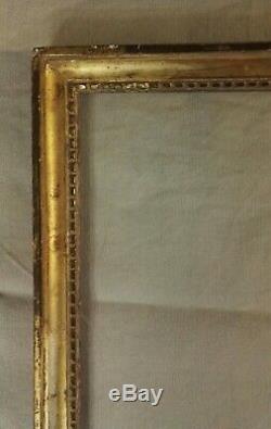 Cadre en bois et stuc doré à la feuille époque Louis XVI