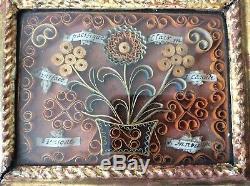 Cadre reliquaire en bois sculpté doré six reliques et paperolles XVIIIème