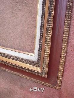 Grand cadre des années contemporain en bois doré feuillure 70 x 58,7 cm