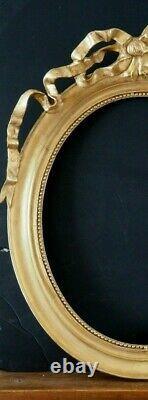 Grand cadre ovale avec fronton au ruban doré style Louis XVI époque XIX siècle