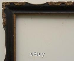 N° 477 Cadre en Bois sculpté doré noirci XVIIIème siècle pour chassis 60 x 46 cm