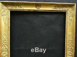 N° 645 CADRE Epoque Empire en bois et stuc doré pour chassis 74.5 x 50 cm