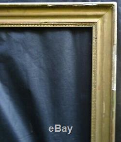 N° 654 CADRE Epoque XIXème en bois doré pour chassis 92.4 x 74.4 cm
