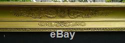 N° 695 CADRE Epoque Empire en bois et stuc doré pour chassis 88 x 69,2 cm
