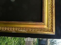 N° 714 CADRE Epoque début XIXème bois et stuc doré pour chassis 65 x 54,8 cm