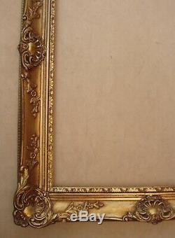 Superbe et imposant cadre en bois doré de style Louis XV format 12 P environ
