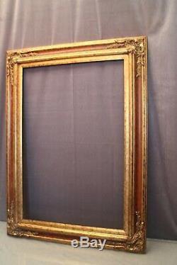 Très grand cadre en bois double patine acajou et or de style Louis XV